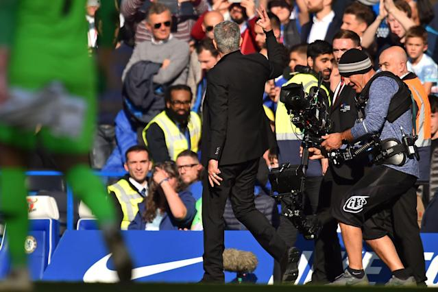 Jose Mourinho taunts Chelsea fans after his Manchester United team got a 2-2 draw at Stamford Bridge. (Getty)