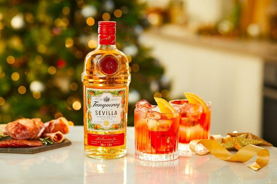"""<p>Pour 35ml <a href=""""https://www.amazon.co.uk/Tanqueray-Flor-Sevilla-Gin-70/dp/B07C8NJV9P/ref=sr_1_2?dchild=1&keywords=Tanqueray+Flor+De+Sevilla&qid=1607530420&sr=8-2"""" rel=""""nofollow noopener"""" target=""""_blank"""" data-ylk=""""slk:Tanqueray Flor De Sevilla"""" class=""""link rapid-noclick-resp"""">Tanqueray Flor De Sevilla</a>, 25ml Campari and 25ml Sweet Vermouth into a glass over ice and stir. For the finishing touch garnish it with a slice of orange.<br></p>"""