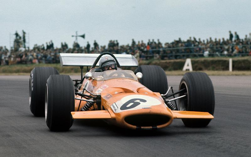 Bruce McLaren on his way to third place in the 1969 British Grand Prix at Silverstone, driving a McLaren-Ford M7C - LAT Photographic