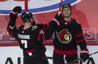 Ottawa Senators center Josh Norris, right, celebrates his overtime goal against the Toronto Maple Leafs with left wing Brady Tkachuk in an NHL hockey game Wednesday, May 12, 2021, in Ottawa, Ontario. (Adrian Wyld/The Canadian Press via AP)