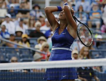 Madison Keys, of the United States, reacts after a shot against Aleksandra Krunic, of Serbia, during the second round of the 2014 U.S. Open tennis tournament, Thursday, Aug. 28, 2014, in New York. (AP Photo/Peter Morgan)