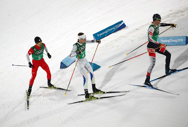 Nordic Combined Events - Pyeongchang 2018 Winter Olympics - Men's Team 4 x 5 km Final - Alpensia Cross-Country Skiing Centre - Pyeongchang, South Korea - February 22, 2018 - Lukas Klapfer of Austria competes with Espen Andersen of Norway and Hideaki Nagai of Japan. REUTERS/Carlos Barria