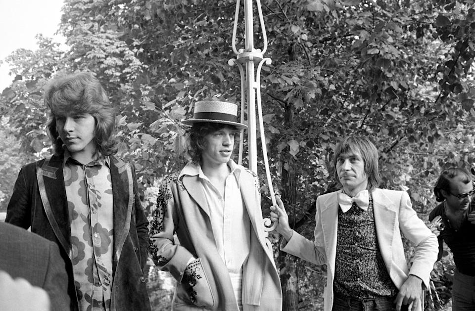 Mick Jagger, center, guitarist Mick Taylor and drummer Charlie Watts, right, of the Rolling Stones speak at a news conference at the Bois de Boulogne in Paris on Sept. 22, 1970.