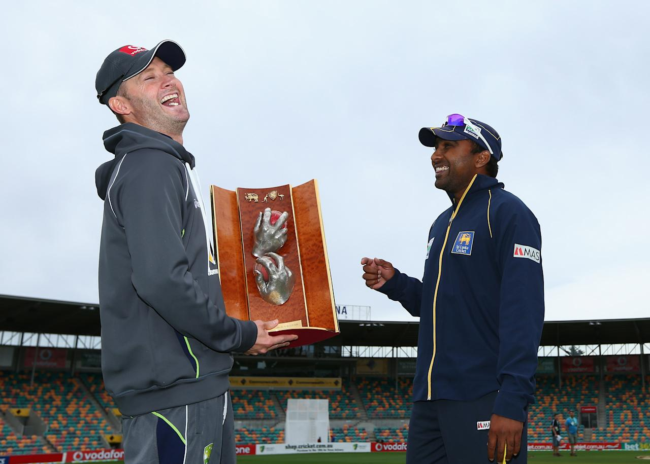HOBART, AUSTRALIA - DECEMBER 13: Michael Clarke of Australia laughs with Mahela Jaywardena of Sri Lanka as they pose for the media with the Warne/Murali Trophy after an Australian nets session at Blundstone Arena on December 13, 2012 in Hobart, Australia.  (Photo by Robert Cianflone/Getty Images)