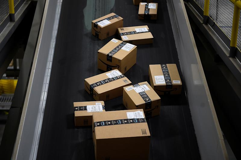 Boxes ready to be loaded onto a delivery truck move along a conveyor belt at the Amazon fulfilment centre in Baltimore, Maryland, U.S., April 30, 2019. REUTERS/Clodagh Kilcoyne
