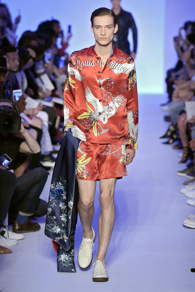 <p>Model wears a deep-red matching pajama set, featuring a vibrant Asian-inspired motif. (Photo: Catwalking) </p>