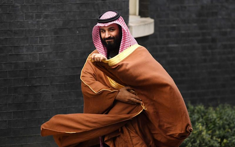 Saudi Arabia's crown prince Mohammad bin Salman arrives at 10 Downing Street in October last year. Once seen as reformer, he has faced criticism for his brutal crackdown on dissidents including the murder ofjournalist Jamal Khashoggi. - PA
