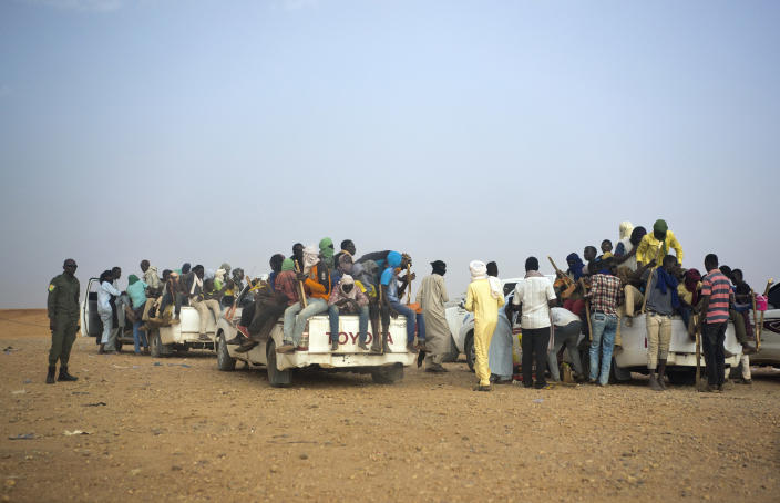 File-This June 14, 2018, file photo shows Nigeriens and third-country migrants head towards Libya from Agadez, Niger. The U.N. humanitarian chief, Mark Lowcock, is hoping a major ministerial meeting on Tuesday, Oct. 20, 2020, will not only raise a billion dollars for the three countries at the epicenter of a humanitarian crisis in Africa's Sahel region -- Burkina Faso, Mali, and Niger -- but spur leaders to address the underlying drivers including increasing conflict and insecurity, weak governance, and a lack of development. (AP Photo/Jerome Delay)