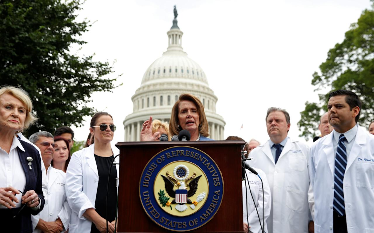 House of Representatives Democratic leader Nancy Pelosi, flanked by healthcare workers, speaks at an event held to protest the proposed Senate Republican healthcare legislation at the U.S. Capitol in Washington, U.S. June 22, 2017.  REUTERS/Kevin Lamarque