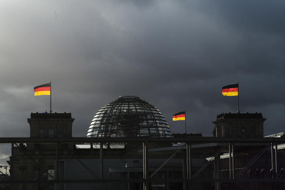 FILE - In this Friday, Nov. 29, 2019 file photo, German national flags catch the sun on top of the German parliament building, the Reichstag building in Berlin, Germany. German voters elect a new parliament on Sunday, Sept. 26, 2021, a vote that will determine who succeeds Chancellor Angela Merkel after her 16 years in power. (Photo/Markus Schreiber, File)