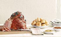 """<p>Fete a crowd—sans stress—with this satisfying, make-ahead fare: sweet-and-spicy ham, mini cheesecakes, and more.</p><p><strong>Appetizer:</strong><br><a href=""""https://www.countryliving.com/food-drinks/recipes/a4267/lemon-goat-cheese-dip-recipe-clv1212/"""" rel=""""nofollow noopener"""" target=""""_blank"""" data-ylk=""""slk:Lemon Goat-Cheese Dip"""" class=""""link rapid-noclick-resp"""">Lemon Goat-Cheese Dip</a></p><p><strong>Main Course:</strong><br><a href=""""https://www.countryliving.com/food-drinks/recipes/a5440/sweet-spicy-cola-glazed-ham-recipe-clv1212/"""" rel=""""nofollow noopener"""" target=""""_blank"""" data-ylk=""""slk:Sweet-and-Spicy Cola-Glazed Ham"""" class=""""link rapid-noclick-resp"""">Sweet-and-Spicy Cola-Glazed Ham</a></p><p><strong>Side Dish:<br></strong><a href=""""https://www.countryliving.com/food-drinks/recipes/a4268/cheddar-biscuits-recipe-clv1212/"""" rel=""""nofollow noopener"""" target=""""_blank"""" data-ylk=""""slk:Cheddar Biscuits"""" class=""""link rapid-noclick-resp"""">Cheddar Biscuits</a></p><p><a href=""""https://www.countryliving.com/food-drinks/recipes/a36647/orange-carrots-yogurt-parsley-dressing/"""" rel=""""nofollow noopener"""" target=""""_blank"""" data-ylk=""""slk:Orange Carrots with Yogurt Parsley Dressing"""" class=""""link rapid-noclick-resp"""">Orange Carrots with Yogurt Parsley Dressing</a></p><p><a href=""""https://www.countryliving.com/food-drinks/recipes/a5858/roasted-acorn-squash-maple-bacon-drizzle-recipe-clx1114/"""" rel=""""nofollow noopener"""" target=""""_blank"""" data-ylk=""""slk:Roasted Acorn Squash with Maple-Bacon Drizzle"""" class=""""link rapid-noclick-resp"""">Roasted Acorn Squash with Maple-Bacon Drizzle</a></p><p><strong>Dessert:<br></strong><a href=""""https://www.countryliving.com/food-drinks/recipes/a4270/mini-brown-sugar-cheesecakes-recipe-clv1212/"""" rel=""""nofollow noopener"""" target=""""_blank"""" data-ylk=""""slk:Mini Brown-Sugar Cheesecakes"""" class=""""link rapid-noclick-resp"""">Mini Brown-Sugar Cheesecakes</a></p><p><strong>Drink:</strong><br><a href=""""https://www.countryliving.com/food-drinks/recipes/a4280/sparkling-winter-sangria-recipe-clv1212/"""" rel="""