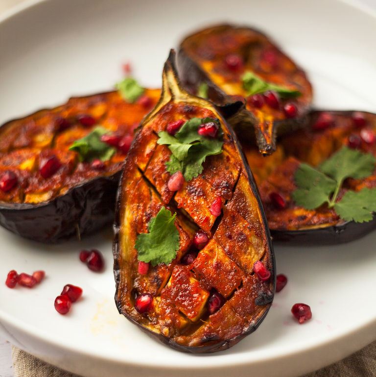 """<p>From curries to slow cooker stews <a href=""""https://www.goodhousekeeping.com/uk/food/cookery-videos/a657341/how-to-prepare-aubergines/"""" rel=""""nofollow noopener"""" target=""""_blank"""" data-ylk=""""slk:aubergines"""" class=""""link rapid-noclick-resp"""">aubergines</a> are a great ingredient and become meltingly tender when roasted in the oven. If thinly sliced and grilled they can also be wonderfully crispy.</p><p>We particularly love a slow cooker curry and recommend our <a href=""""https://www.goodhousekeeping.com/uk/food/recipes/a33542472/slow-cooker-vegan-jalfrezi/"""" rel=""""nofollow noopener"""" target=""""_blank"""" data-ylk=""""slk:slow cooker aubergine and sweet potato jalfrezi"""" class=""""link rapid-noclick-resp"""">slow cooker aubergine and sweet potato jalfrezi</a>. If you're looking for something easier how about our <a href=""""https://www.goodhousekeeping.com/uk/food/recipes/a568678/miso-aubergines-spring-green-rice/"""" rel=""""nofollow noopener"""" target=""""_blank"""" data-ylk=""""slk:quick miso aubergines with spring green rice"""" class=""""link rapid-noclick-resp"""">quick miso aubergines with spring green rice</a>.</p>"""