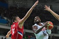 USA's Kyrie Irving (R) goes for the basket past Serbia's Nikola Jokic during their Group A basketball match, at the Rio 2016 Olympic Games, on August 12 (AFP Photo/Andrej Isakovic)