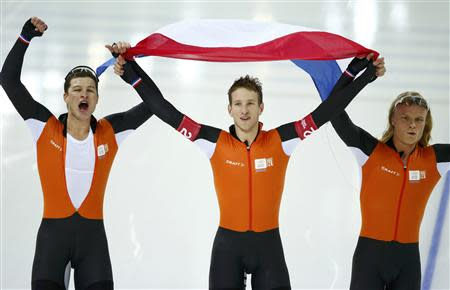 The team from the Netherlands,Sven Kramer, Jan Blokhuijsen and Koen Verweij celebrate after competing in the men's speed skating team pursuit Gold-medal final during the 2014 Sochi Winter Olympics