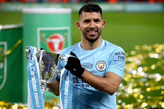 Sergio Aguero holds the 2018 League Cup trophy