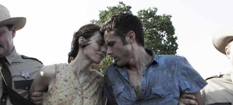"""This undated publicity photo provided by the Sundance Institute shows Rooney Mara, left, and Casey Affleck, right, in a scene from the film, """"Ain't Them Bodies Saints,"""" included in the U.S. Dramatic Film competition at the 2013 Sundance Film Festival. (AP Photo/Sundance Institute, Steve Dietl)"""