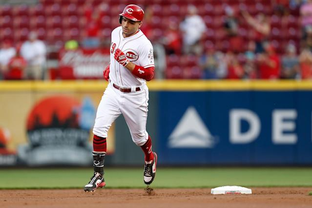 Joey Votto probably won't win NL MVP but that doesn't mean he's not a better player than Giancarlo Stanton. (Getty Images)