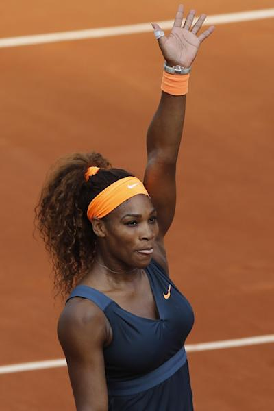 Serena Williams of the U.S. celebrates defeating Italy's Sara Errani in two sets 6-0, 6-1, in their semifinal match at the French Open tennis tournament, at Roland Garros stadium in Paris, Thursday June 6, 2013. (AP Photo/Christophe Ena)