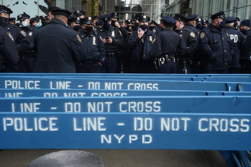 Police attend a muster point near Times Square ahead of New Year's Eve
