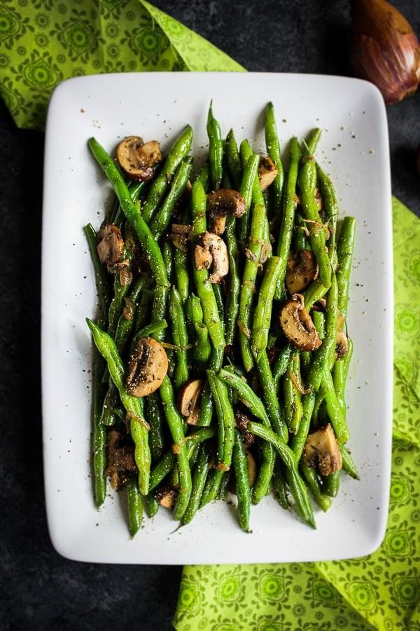 "<p>This take on green bean casserole is really just fresh green beans with onions and mushrooms. If green beans are on your menu this year, you'll want to cut this recipe in half to only serve two. </p><p><strong>Get the recipe:</strong> <a href=""http://delightfulemade.com/2019/11/12/healthy-green-bean-casserole/"" class=""link rapid-noclick-resp"" rel=""nofollow noopener"" target=""_blank"" data-ylk=""slk:healthy green bean casserole"">healthy green bean casserole</a></p>"