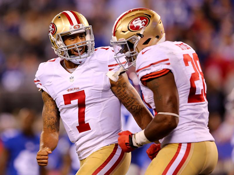 Colin Kaepernick and Carlos Hyde were teammates on the San Francisco 49ers. (Photo by Elsa/Getty Images)