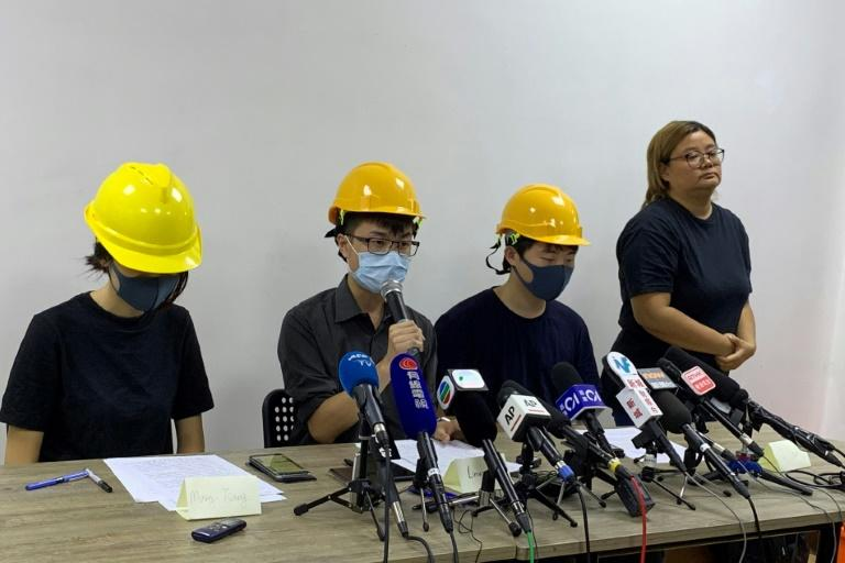 Three masked participants from the protests held a press conference to condemn the city's pro-Beijing leaders (AFP Photo/Vanessa YUNG)