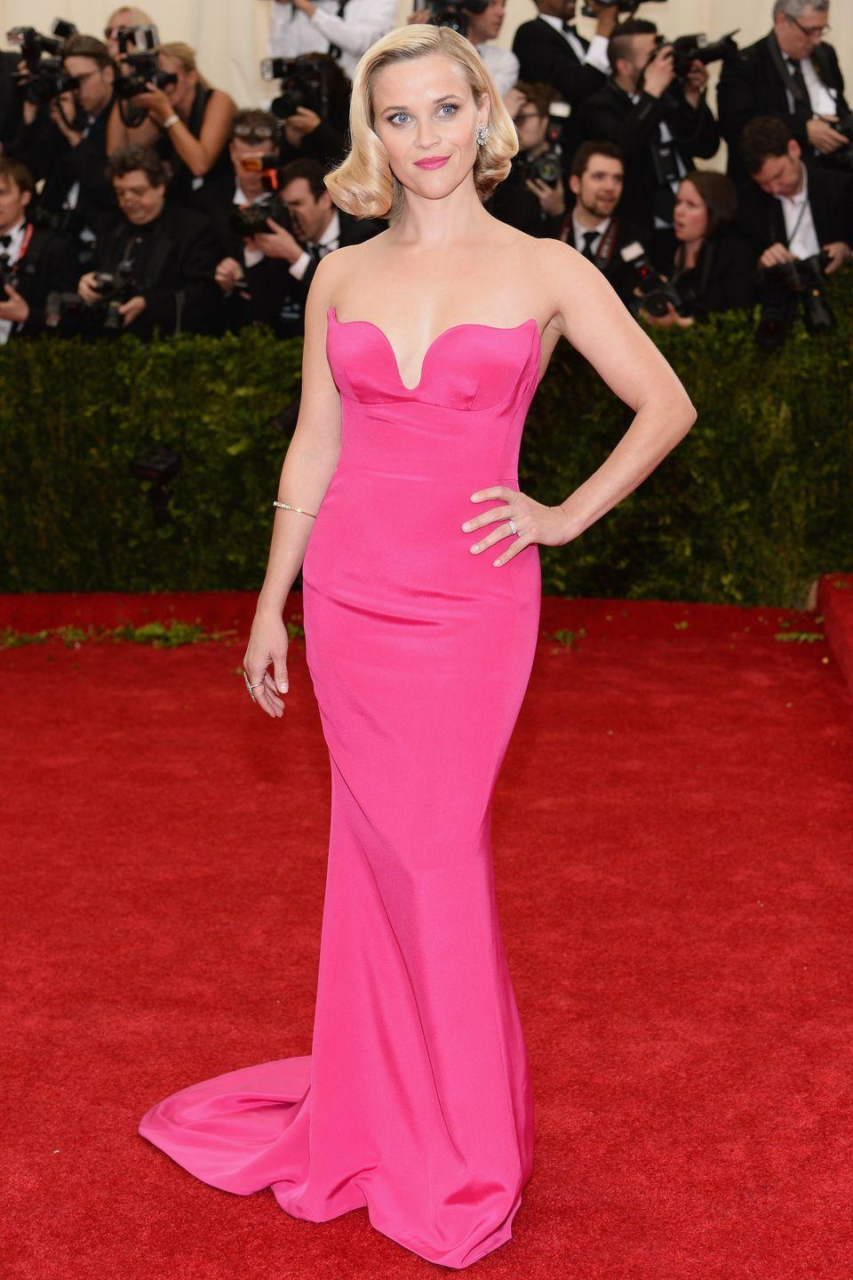 <p>At the 2014 Met Gala, Reese Witherspoon wore a strapless dress in the same shade as Princess Aurora's pink gown.</p>