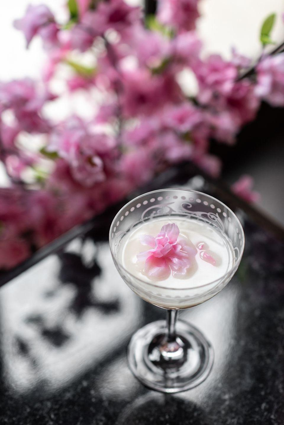 """<p>This delightful cocktail from St. Regis Bar at <a href=""""https://www.marriott.com/hotels/travel/wassx-the-st-regis-washington-dc/"""" rel=""""nofollow noopener"""" target=""""_blank"""" data-ylk=""""slk:The St. Regis Washington, D.C."""" class=""""link rapid-noclick-resp"""">The St. Regis Washington, D.C.</a> is worth the effort to make, and serves enough for an intimate garden party, as it makes a gallon. Use garnishes from your garden to create a drink as beautiful as it is delicious.</p><p><strong>Ingredients:</strong></p><p>1 quart plum brandy</p><p>1 quart Tanqueray No.10 (or other London dry gin)</p><p>1/2 quart apricot liquor</p><p>2 quarts hibiscus tea</p><p>1 quart lemon juice</p><p>1/2 quart strawberry syrup</p><p>2 quarts milk of choice (we advise steering clear of fat-free options)</p><p>sliced strawberries, sprigs of mint, dried orange slices, brandy cherries, for garnish (optional)</p><p><strong>Directions:</strong></p><ol><li>Add plum brandy, gin, apricot liquor, hibiscus tea, lemon juice, and strawberry syrup into a container and mix. </li><li>Pour the mixture gentle over a container filled with two quarts of milk and let sit for 24 hours. You can either strain mixture carefully into a chinois or layer coffee filters in a strainer. Let this drip overnight. Repeat 3-4 times.</li><li>Pour mixture over ice in highball glasses and serve cold.</li></ol>"""