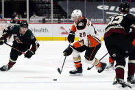Anaheim Ducks left wing Nicolas Deslauriers (20) carries the puck between Arizona Coyotes defenseman Jordan Oesterle (82) and right wing Christian Fischer (36) during the first period of an NHL hockey game Wednesday, Feb. 24, 2021, in Glendale, Ariz. (AP Photo/Rick Scuteri)