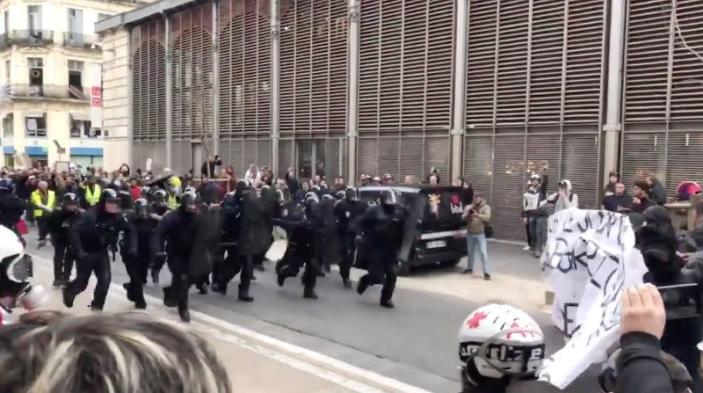 Police charge towards demonstrators during protests against French government's pensions reform plans, in Montpellier