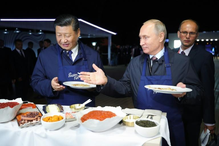 Russian President Vladimir Putin and his Chinese counterpart Xi Jinping found time to flip pancakes