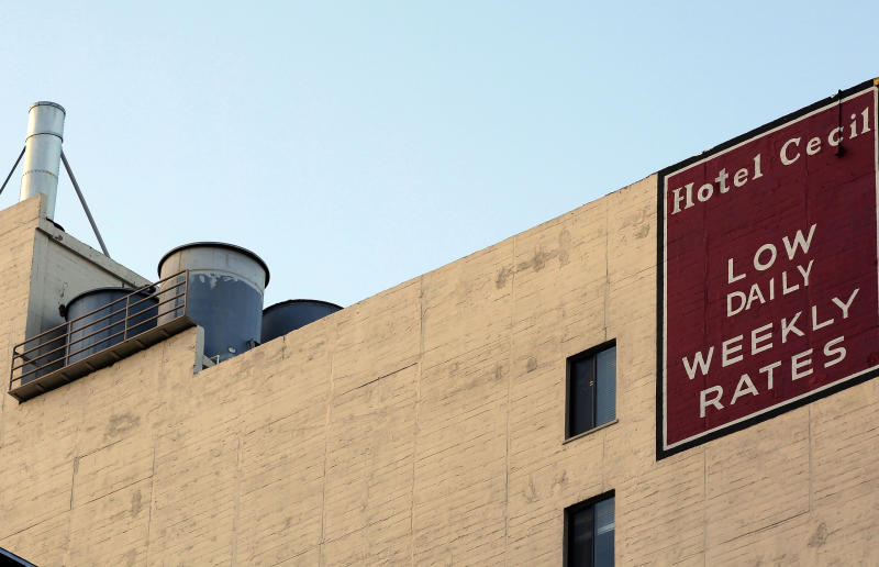 FILE - Water tanks seen on the roof of the Hotel Cecil in a Wednesday Feb. 20,2013 file photo. Police say the body of a missing Canadian woman was found Tuesday at the bottom of one of four cisterns on the roof of the hotel. The tanks provide water for hotel taps and would have been used by guests for washing and drinking. Los Angeles County Department of Public Health officials were expected to release the results of tests on the water on Thursday, Feb. 21. Investigators used body markings to identify 21-year-old Elisa Lam, police spokeswoman Officer Diana Figueroa said late Tuesday. (AP Photo/Nick Ut, File)