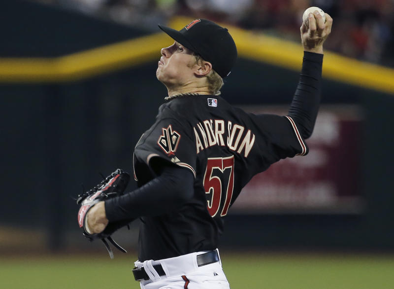 Arizona Diamondbacks pitcher Chase Anderson throws against the Los Angeles Dodgers during the first inning of a baseball game Saturday, May 17, 2014, in Phoenix. (AP Photo/Matt York)