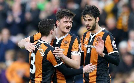 Hull City's Andrea Ranocchia, Harry Maguire and Andrew Robertson celebrate after the match