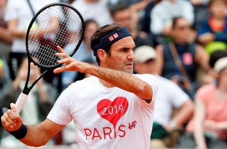 Tennis - French Open - Roland Garros, Paris, France - May 25, 2019 Switzerland's Roger Federer attends a training session on the eve of the start of the tournament REUTERS/Vincent Kessler