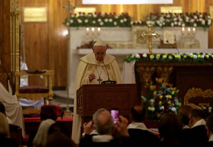 Pope Francis, center, leads a mass at Mar Youssef Church in Baghdad, Iraq, Saturday, March 6, 2021. Pope Francis and Iraq's top Shiite cleric delivered a powerful message of peaceful coexistence Saturday, urging Muslims in the war-weary Arab nation to embrace Iraq's long-beleaguered Christian minority during an historic meeting in the holy city of Najaf. (AP Photo/Khalid Mohammed)