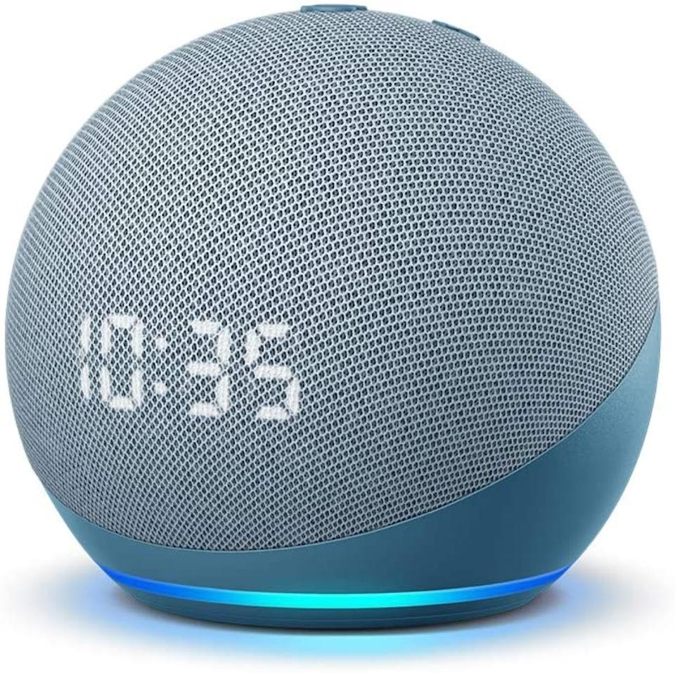 gray echo dot smart home device displaying 10:35 time