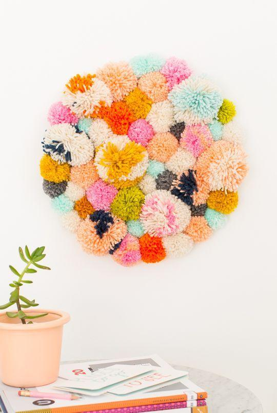 "<p>Make your room into a colourful cave with an adorable pom pom wall hanging.  <i><a href=""https://uk.pinterest.com/pin/206884176608661476/"">[Photo: Pinterest]</a></i></p>"
