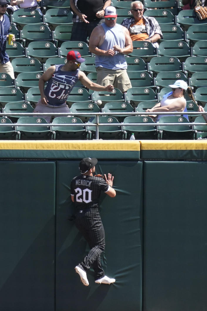Chicago White Sox center fielder Danny Mendick can't make the play on a solo home run hit by Detroit Tigers' Miguel Cabrera during the sixth inning of a baseball game in Chicago, Saturday, June 5, 2021. (AP Photo/Nam Y. Huh)