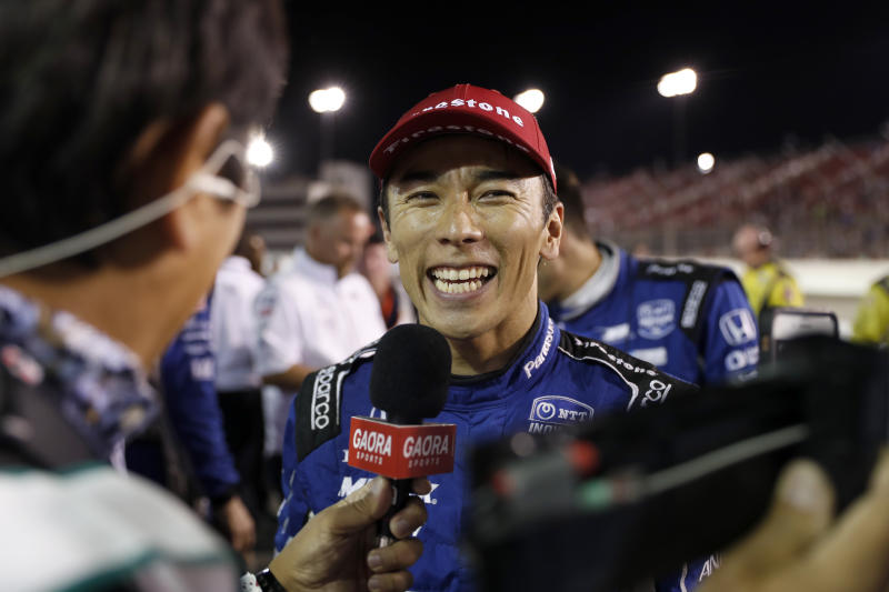 Takuma Sato smiles as he is interviewed after winning the IndyCar auto race at World Wide Technology Raceway on Saturday, Aug. 24, 2019, in Madison, Ill. (AP Photo/Jeff Roberson)