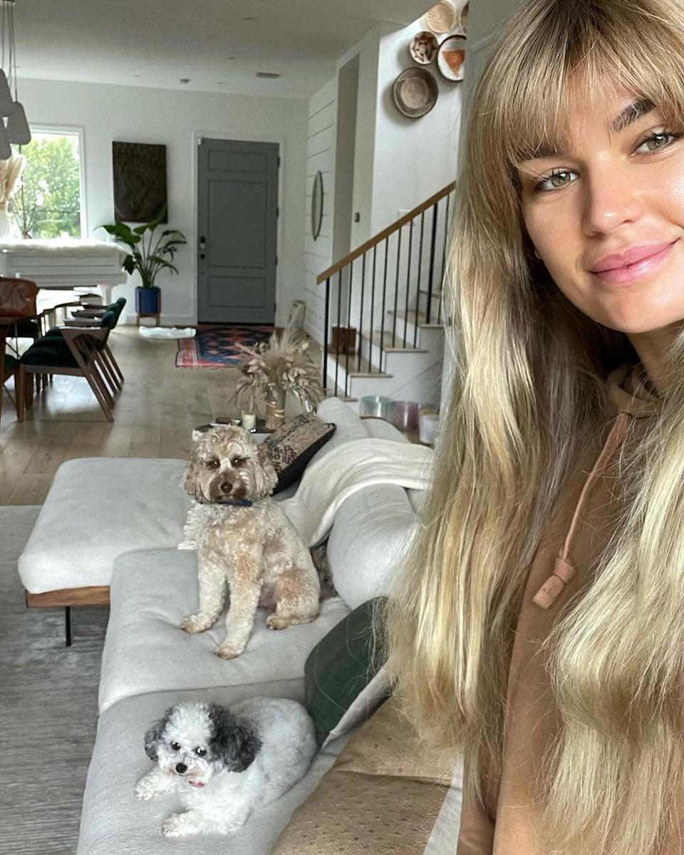 """<p>The model snapped a pic of her two cute pups — Panda and Oliver — in her Venice Beach, California, home to celebrate National Puppy Day. """"I am one proud momma to these two trouble-makers,"""" <a href=""""https://www.instagram.com/p/CMxs_knD0z6/"""" rel=""""nofollow noopener"""" target=""""_blank"""" data-ylk=""""slk:she wrote"""" class=""""link rapid-noclick-resp"""">she wrote</a>. </p>"""