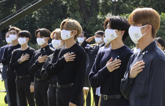 "FILE - In this Sept. 19, 2020, file photo, South Korean K-pop group BTS salutes to their national flag during a ceremony marking the National Youth Day at the presidential Blue House in Seoul, South Korea. BTS released a statement condemning racism against Asians and Asian Americans and Pacific Islanders (AAPI) on Tuesday, March 30, 2021. ""We stand against racial discrimination,"" the biggest boyband in the world, tweeted to their 34 million followers in both English and Korean. (Lee Jin-wook/Yonhap via AP)"