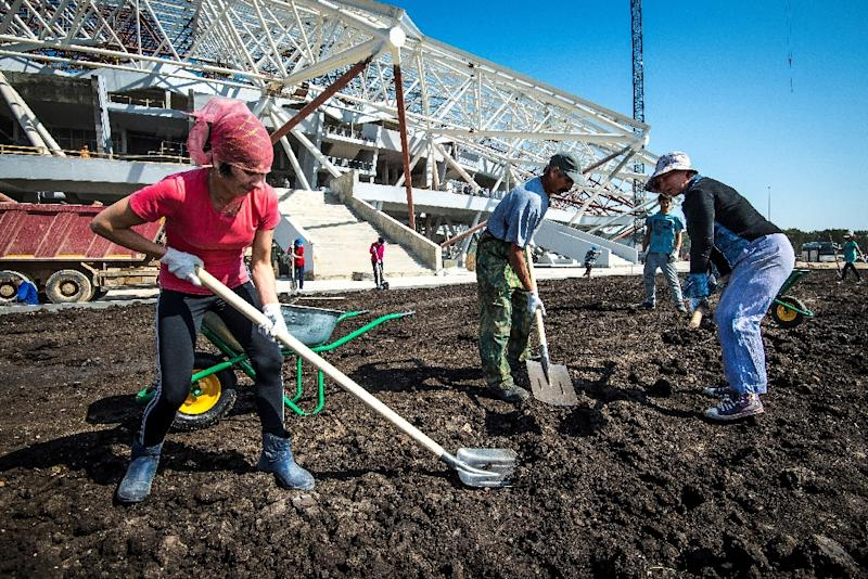 Workers in Samara prepared to install the pitch last August, but the grass is only now ready to be laid