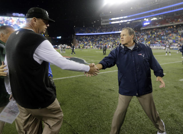 New York Jets head coach Rex Ryan, left, and New England Patriots head coach Bill Belichick shake hands after their teams' NFL football game Thursday, Sept. 12, 2013, in Foxborough, Mass. The Patriots won 13-10. (AP Photo/Charles Krupa)