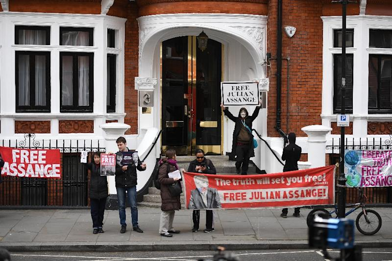 Supporters of WikiLeaks founder Julian Assange display banners and placards as they gather outside the Ecuadorian Embassy in London, where Assange has been living for more than six years and will meet with an independent rights expert (AFP Photo/Daniel LEAL-OLIVAS)