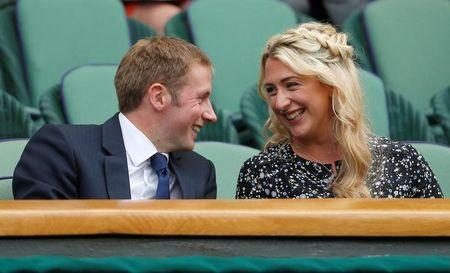 Tennis - Wimbledon - London, Britain - July 8, 2017 Cyclists Jason and Laura Kenny in the stands on centre court REUTERS/Andrew Couldridge