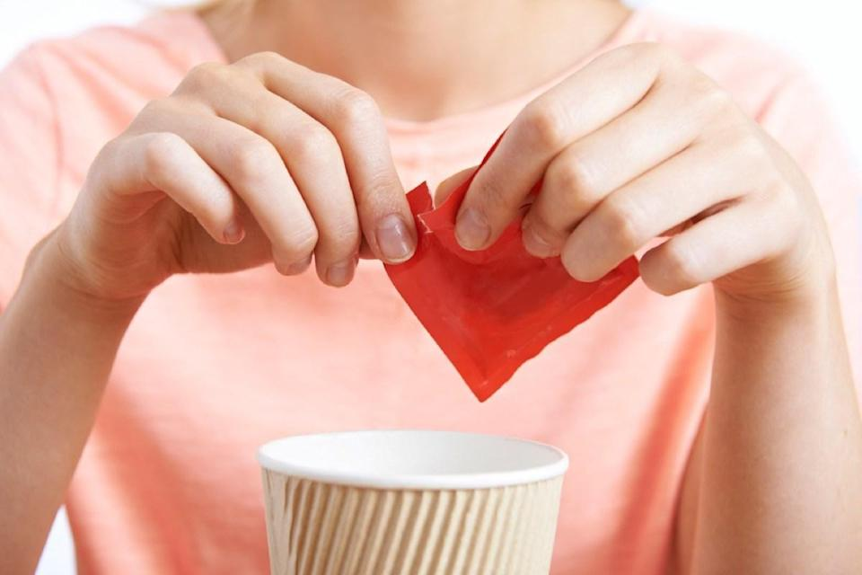 """Ditch that artificial sweetener in your coffee or tea and you'll be healthier in no time. A 2010 study published in the <em>Yale Journal of Biology and Medicine </em>found that not only do artificial sweeteners <a href=""""https://www.ncbi.nlm.nih.gov/pmc/articles/PMC2892765/"""" rel=""""nofollow noopener"""" target=""""_blank"""" data-ylk=""""slk:increase a person's risk of weight gain"""" class=""""link rapid-noclick-resp"""">increase a person's risk of weight gain</a>, but they make people more likely to crave real sugar, too."""