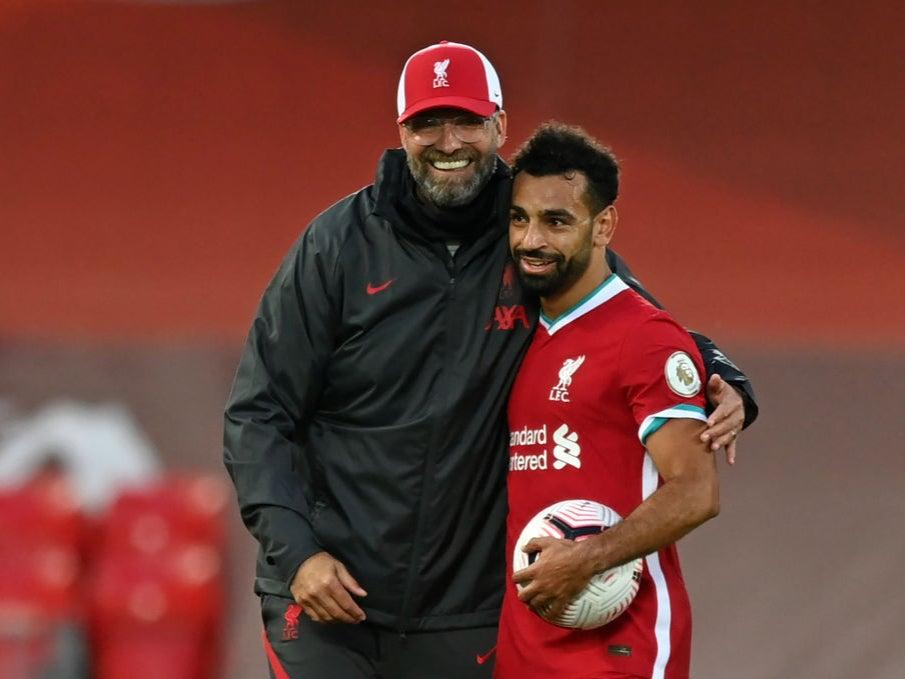 Mohamed Salah is congratulated by manager Jurgen KloppGetty Images