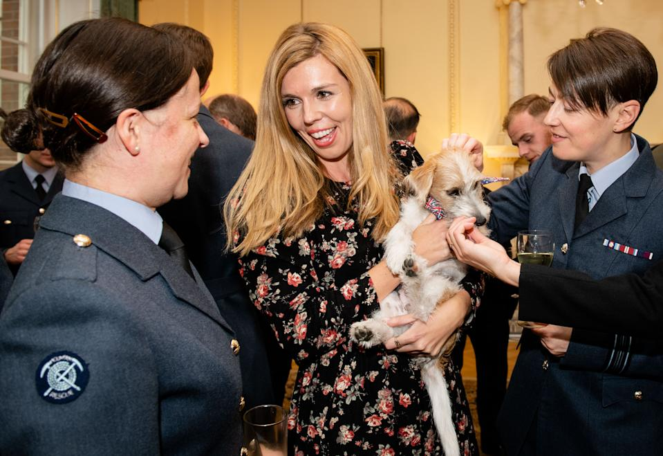 Carrie Symonds wears yet another excellent floral dress during a reception for the Armed Forces at No.10. She styled it with her blonde hair perfectly coiffed and minimal makeup. <em>[Photo: Getty Images]</em>