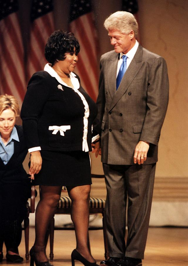 <p>Aretha Franklin receiving an award from President Bill Clinton and wife Hillary in 2000. (Rex) </p>